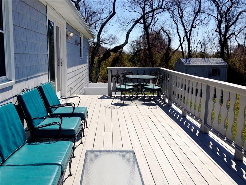 Relax on this spacious wraparound deck, which provides space for grilling and outdoor dining