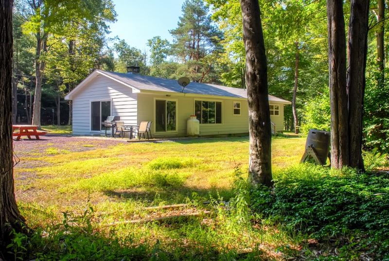 You'll love the idyllic location of this lovely Pocono Lake vacation rental home!