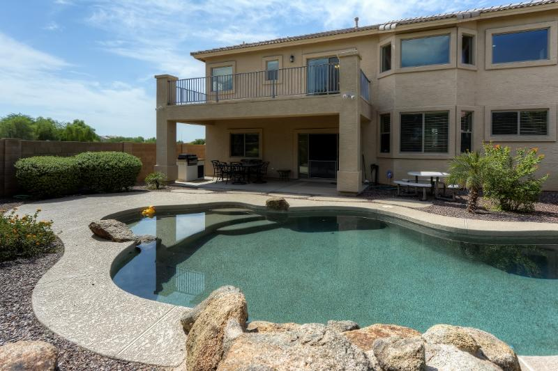 You'll love spending your vacation days lounging by this Maricopa vacation rental home's sparkling heated outdoor swimming pool!