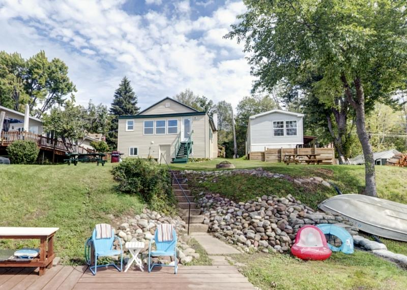 Choose this spectacular waterfront Wolcott vacation rental home for your next relaxing New York retreat!