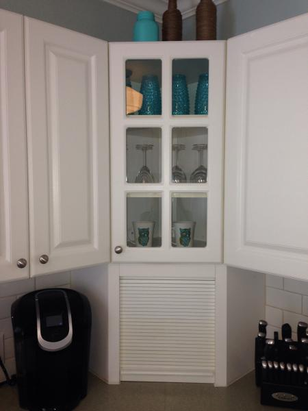 Kitchen is complete with coffee maker, kettle and keurig.