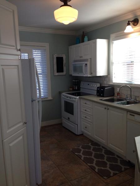 Fully equipped kitchen with tons of cabinetry.