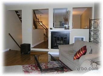 Relax in your living room with fireplace and hardwood floors.