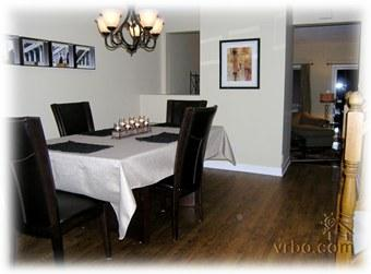 Spacious separate dining room equipped for six, overlooks the sunken living room.