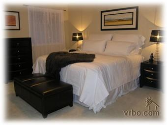 Master bedroom with wall to wall closets and ensuite bathroom.