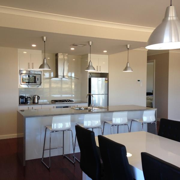 Open plan kitchen, dining, living with full kitchen facilities including a dishwasher.