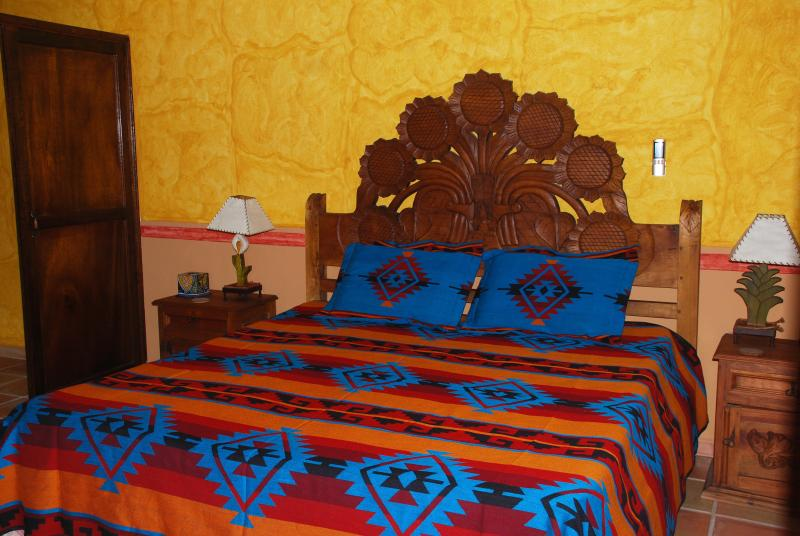 Hand carved Mexican crafted headboards let you know you are not in a generic hotel!