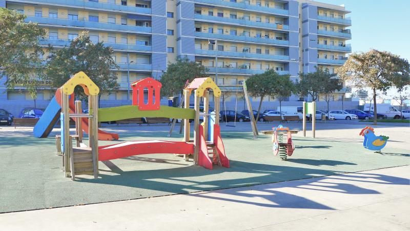 children´s playground in front of the apartment´s building