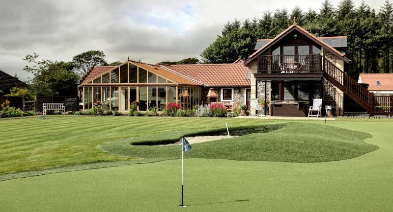 Exterior showing short game golf area, BBQ and hyrdo spa