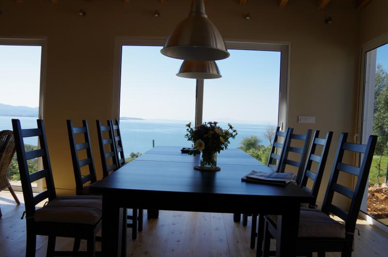 Dining area with pool and sea views