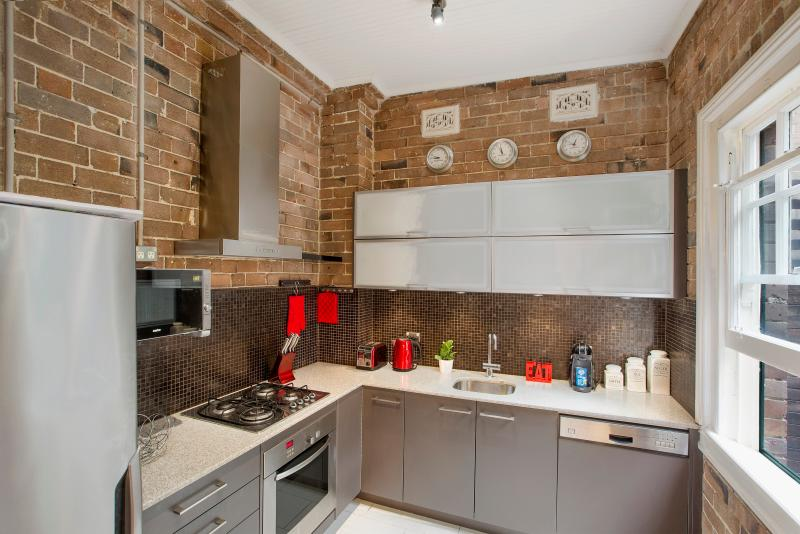Super stylish industrial warehouse style kitchen is fully equipped with everything you could need