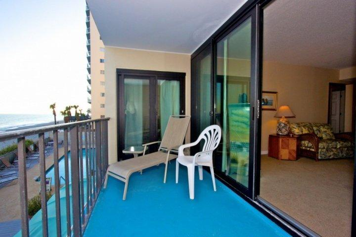 Enjoy the beach from your first floor balcony, one story above the ground.
