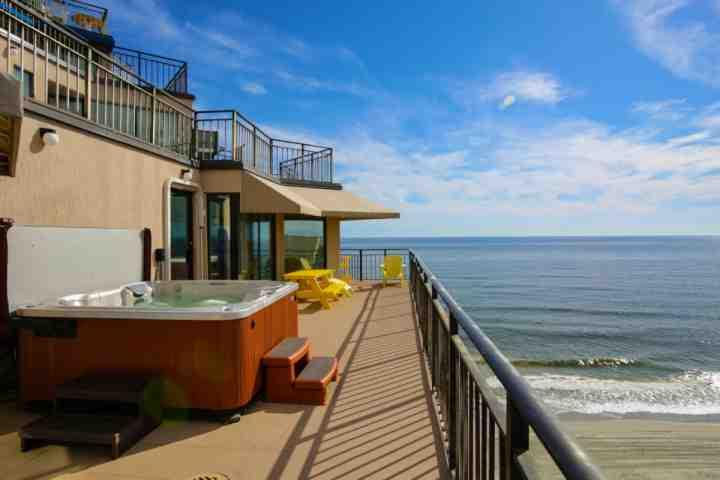 Enjoy the sweeping beach view from your private hot tub, or lots of comfortable balcony furniture