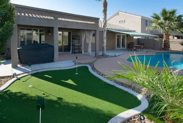 Golf enthusiasts will delight in the home's putting green.