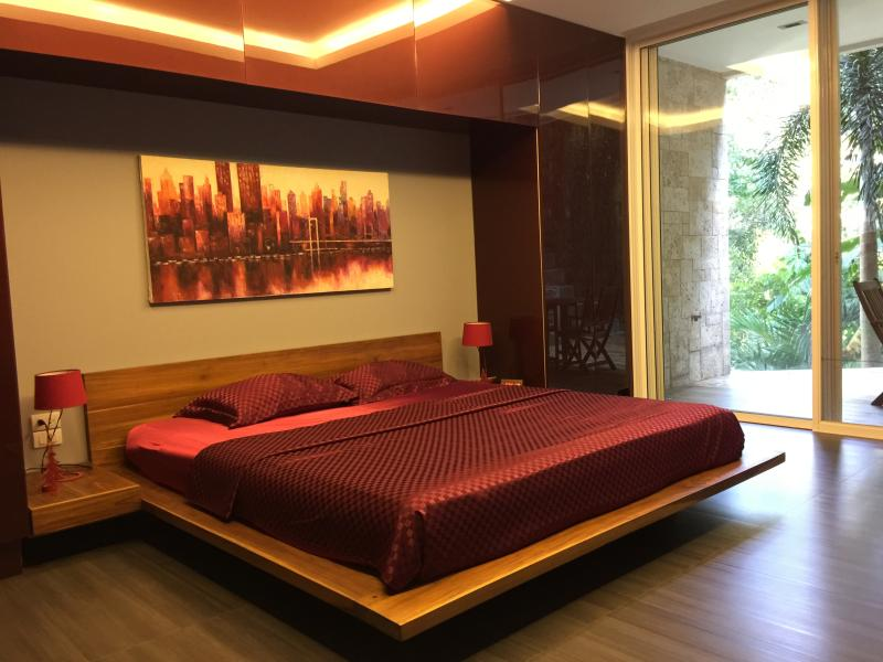 Teak wood bed, with King sized Top Quality Omazz luxury mattress.