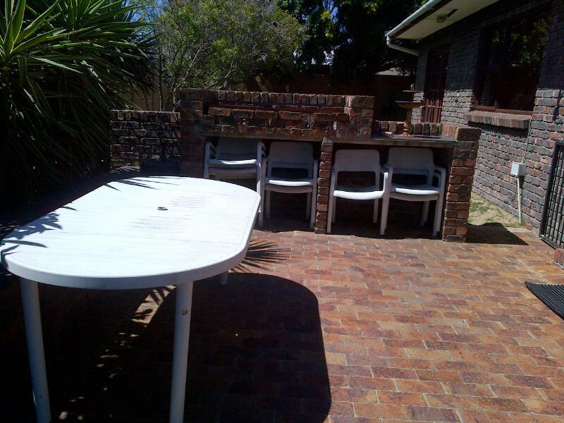 Outside the lounge area is the braai area with table and chairs. This is for your use by arrangement