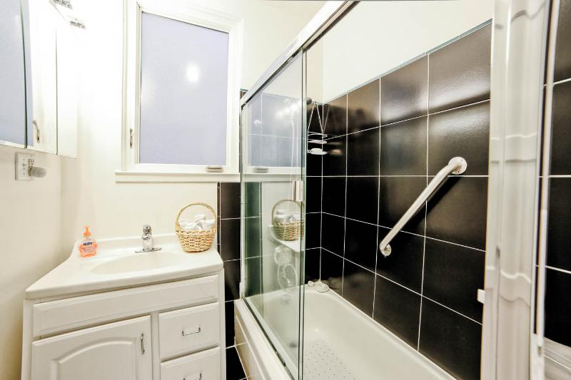 Split bath. This room with vanity and tub/shower. Another with toilet.