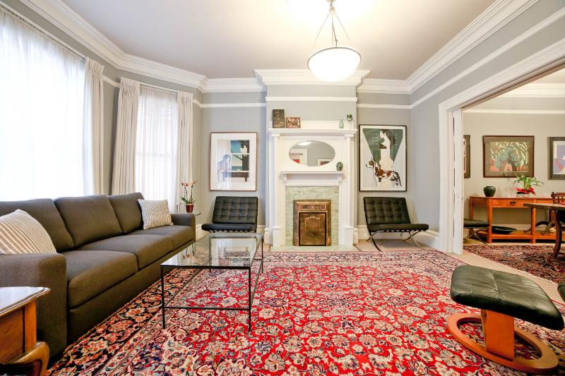Formal Living Room from Entry - Oriental Carpets, Period Detail, Barcelona Chairs, Original Artwork.