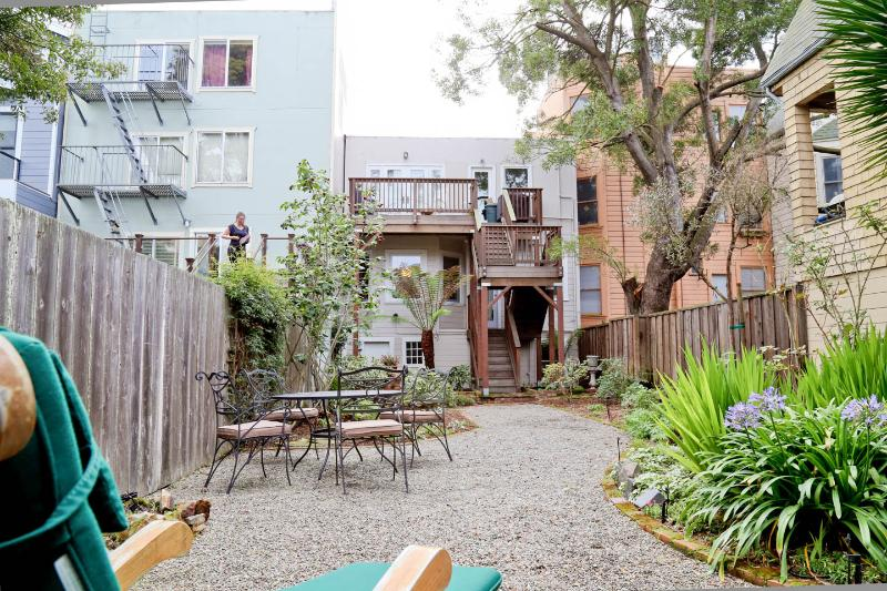 Well Maintained Garden. Wrought Iron Table & Chairs. Teak Deck Chairs. Enjoy Morning Coffee.