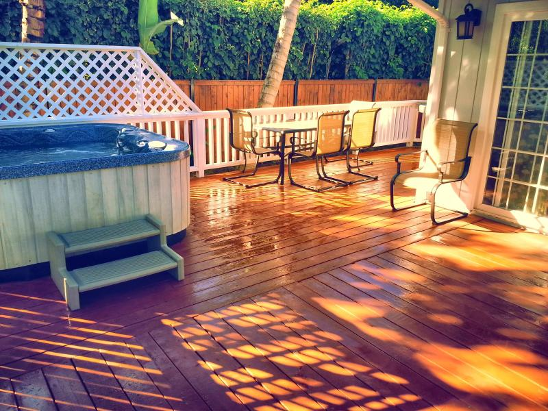 Huge deck with hot tub, 6 person dining table, and high end Weber gas grill
