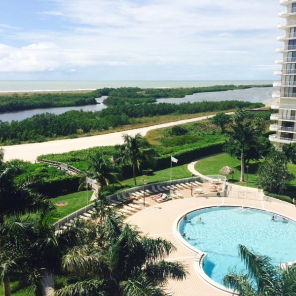 Stunning view of the pool, gulf access and beach from our lanai.