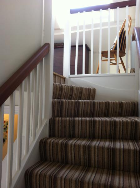 There is one small internal flight of stairs leading up to the open plan area.