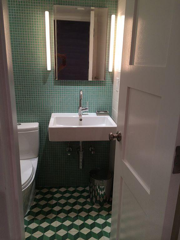 New bathroom European fixtures and Moroccan floor tiles.