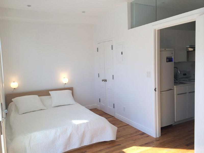 Comfortable queen size bed and convenient closet.