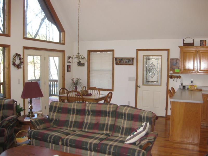 Showing dining area and breakfast bar.