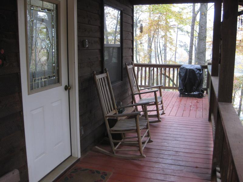 Covered porch with rockers and BBQ grill