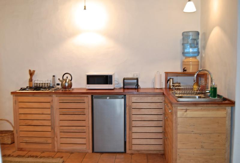 a well equipped kitchen invites to prepare local produce