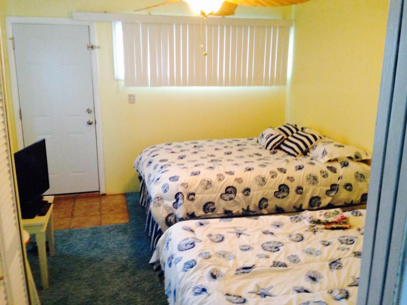 Two Queen beds, dresser, TV, DVD, Ceiling Fan