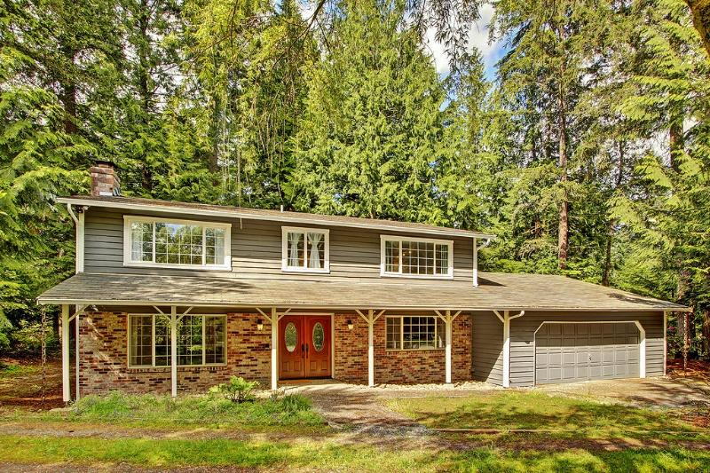 You'll love the tree-filled acre on which this peaceful, recently remodeled Woodinville vacation rental home sits.
