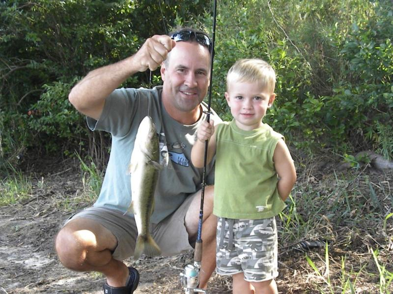 Little fisherman and his father with their catch on our private beach
