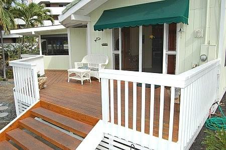 Front Deck , area for our  ice chests, boogie boards, beach chairs, kids plastic pool, your Gas BBQ