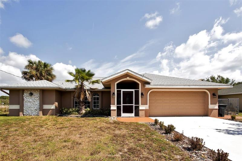 The home offers garage and driveway parking!