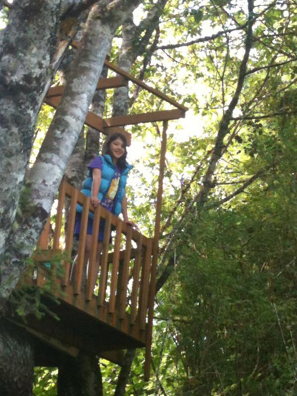 girl in treehouse