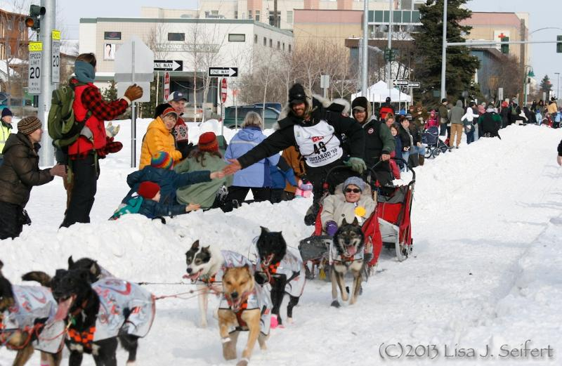 Lance mackey passes by one block away on The Iditarod Trail