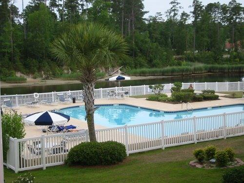 Partial view of large pool & hot tub on waterway