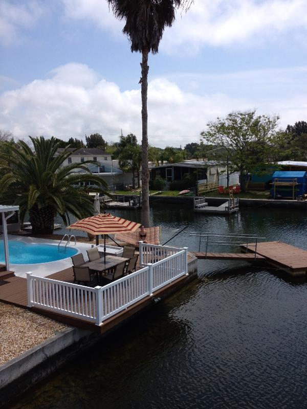 Poolside patio set, outdoor hammock, and floating dock!