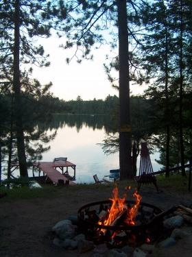 View of lake over evening bonfire