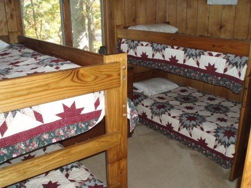 guest room with 4 bunkbeds