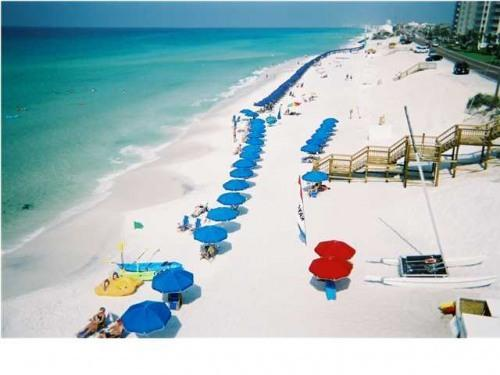 Free Beach Service: 2 chairs and umbrella included with rental (March-October)