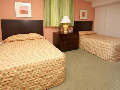2nd Bedroom with private access to large bath with 2 Double Beds & HDTV