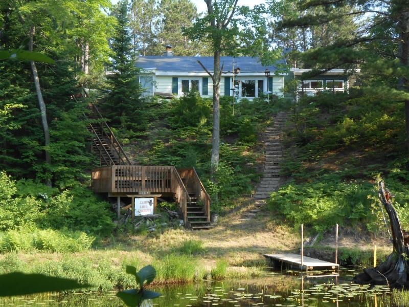 Riverfront cottage with open wood deck and floating dock