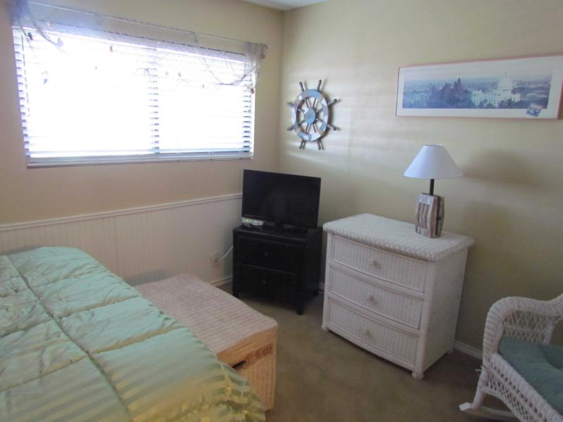 spacious back bedroom with flat screen TV and cable TV