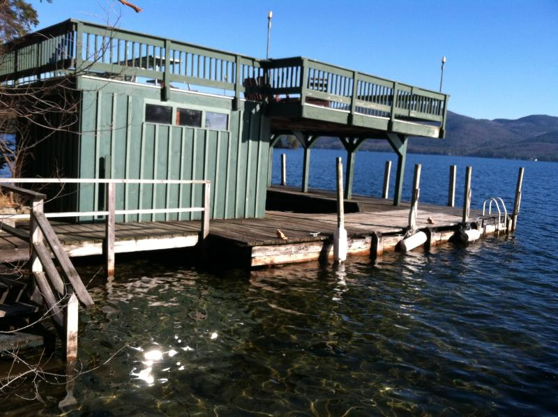 The boat house w/ covered boat slip, swimming in 1.5 - 8 feet of water,& ladder.