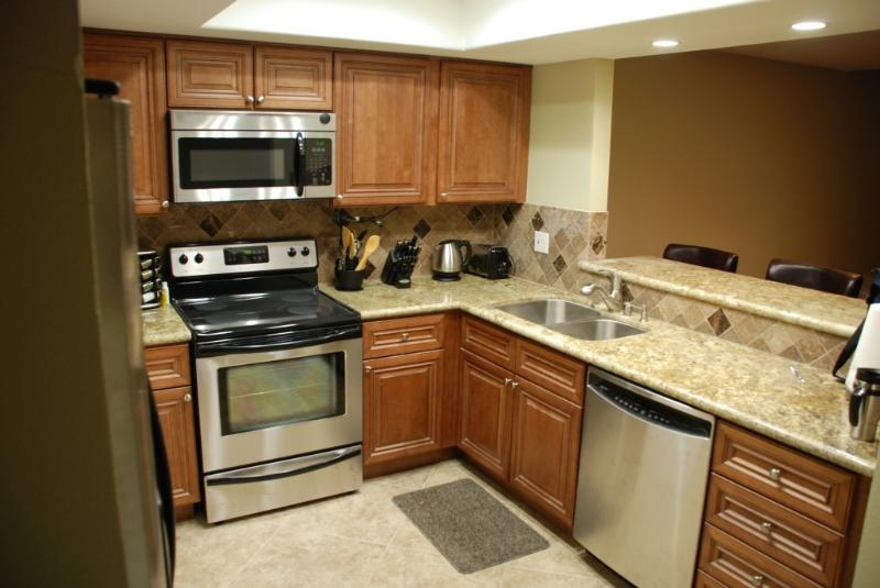 A Chef's choice kitchen w/high end cookware, spice