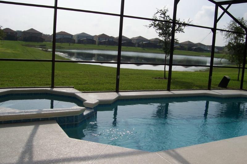 Pool and lanai overlooking beautiful pond
