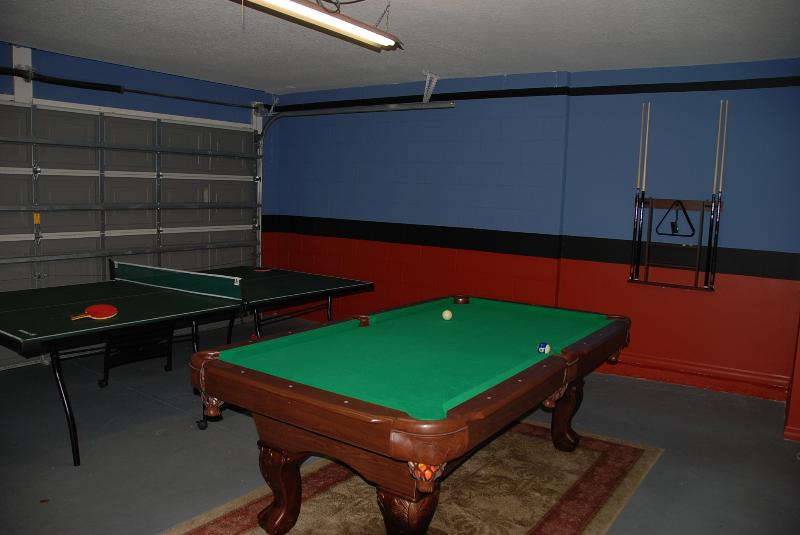 games room with full size pool table and ping-pong